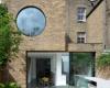 保罗阿彻设计的JimiHouse设有受抽象艺术启发的圆形窗户